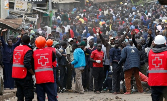 Red Cross members stands near protesters supporting opposition leader Raila Odinga in Mathare, in Nairobi, Kenya August 12, 2017. (Reuters/Thomas Mukoya)