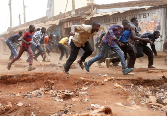 Supporters of opposition leader Raila Odinga run away from police during clashes in Kibera slum in Nairobi, Kenya, August 12, 2017.  (Reuters/Goran Tomasevic)