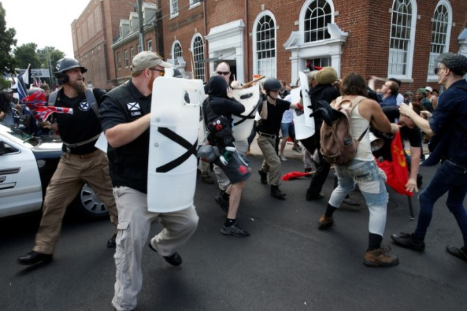 Members of white nationalists clash a group of counter-protesters in Charlottesville, Virginia, U.S., August 12, 2017.   REUTERS/Joshua Roberts