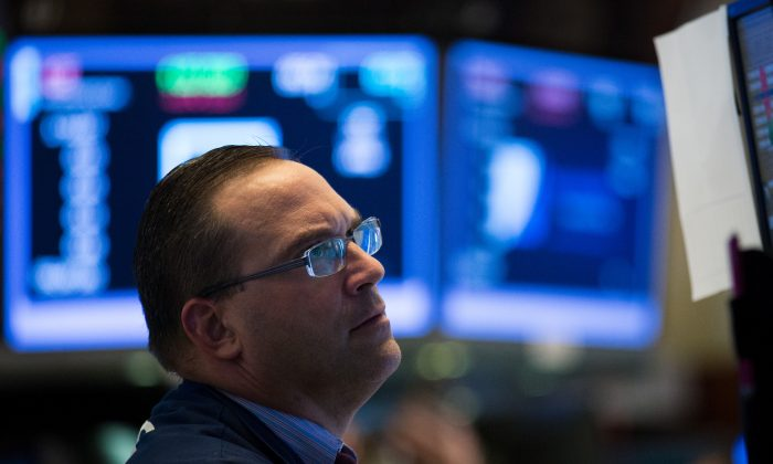 A trader works on the floor of the New York Stock Exchange (NYSE) ahead of the closing bell, July 18, 2017 in New York City. (Drew Angerer/Getty Images)