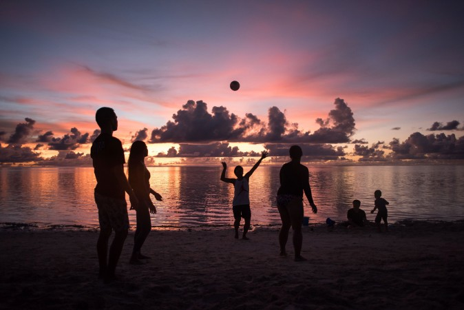 People play volleyball on a beach at Tumon Bay in Guam, on Aug. 12, 2017. (ED JONES/AFP/Getty Images)