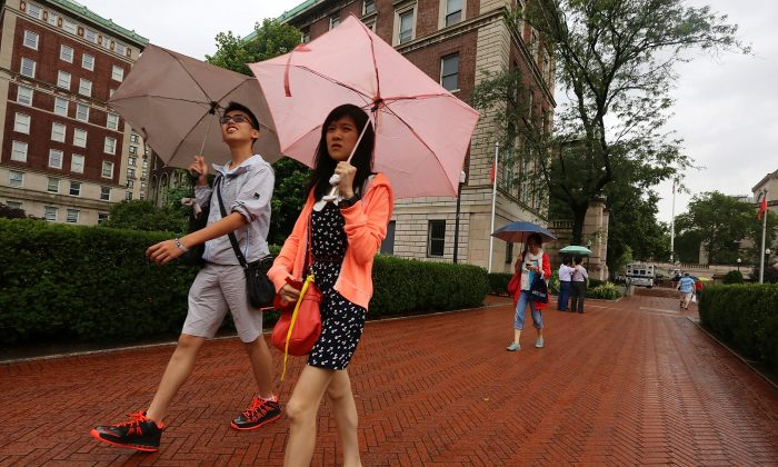 People walk on the Columbia University campus in New York City on July 1, 2013. (Mario Tama/Getty Images)
