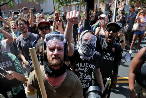 "Armed members of the Antifa extremist group wait outside Emancipation Park to hurl insults as members of various groups, including white nationalists and neo-Nazis, are forced out after the ""Unite the Right"" rally was declared an unlawful gathering August 12, 2017 in Charlottesville, Virginia. (Chip Somodevilla/Getty Images)"