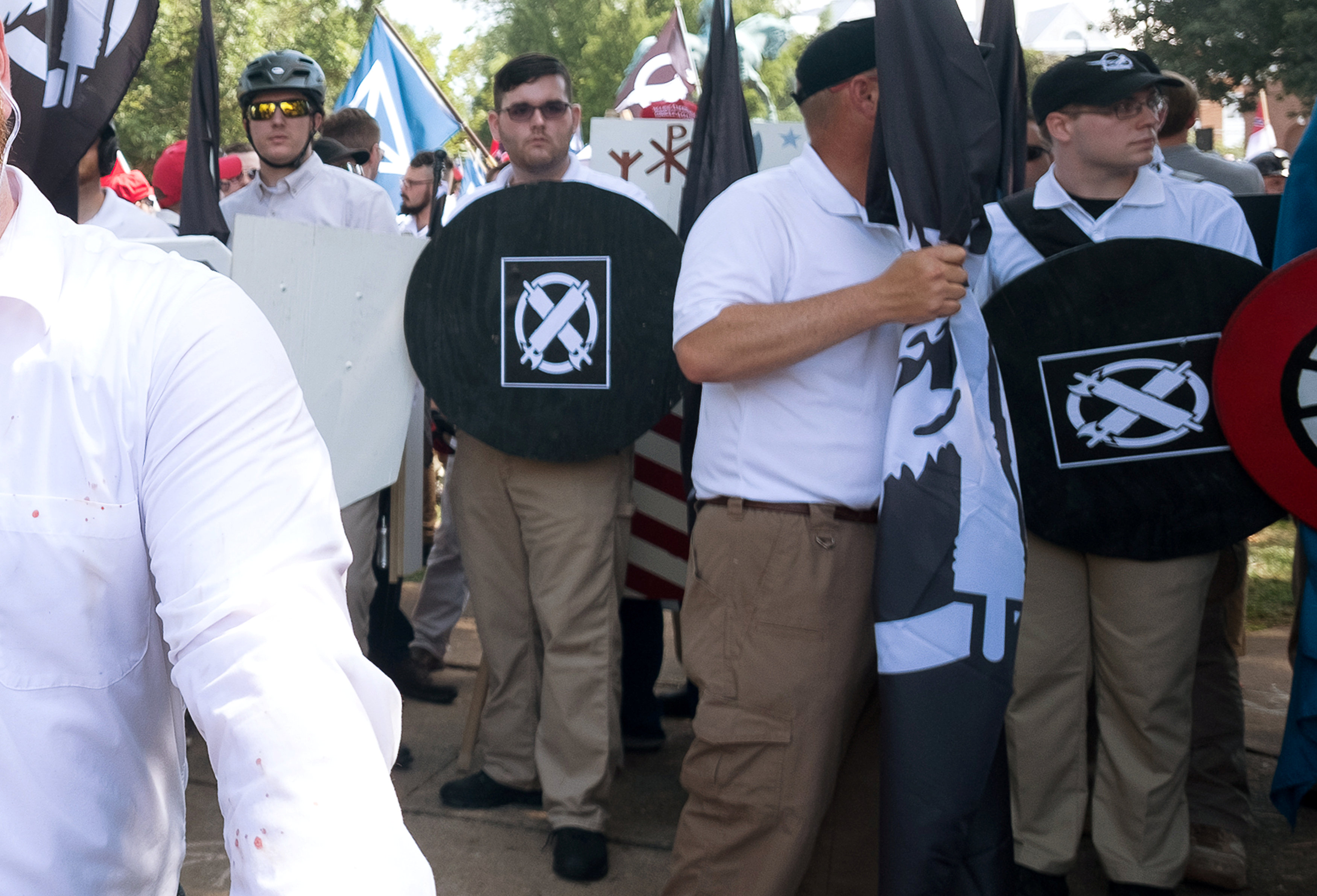 "James Alex Fields Jr., (2nd L with shield) is seen attending the ""Unite the Right"" rally in Emancipation Park in Charlottesville, Virginia, on August 12, 2017. (REUTERS/Eze Amos)"