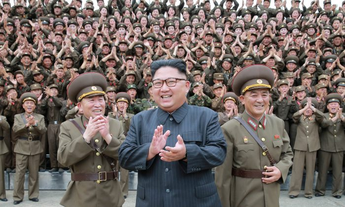 North Korean leader Kim Jong Un with military officers at the Command of the Strategic Force of the Korean People's Army (KPA) in an unknown location in North Korea on August 15, 2017.   (KCNA/via Reuters)