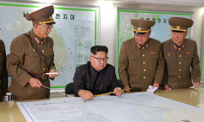 North Korean leader Kim Jong Un visits the Command of the Strategic Force of the Korean People's Army (KPA) in an unknown location in North Korea in this undated photo released by North Korea's Korean Central News Agency (KCNA) on August 15, 2017. (KCNA/via Reuters)