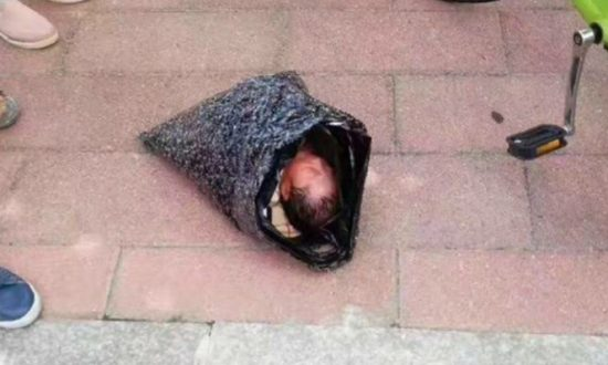 Mother Puts Baby in Plastic Bag, Tries to Mail It to Orphanage