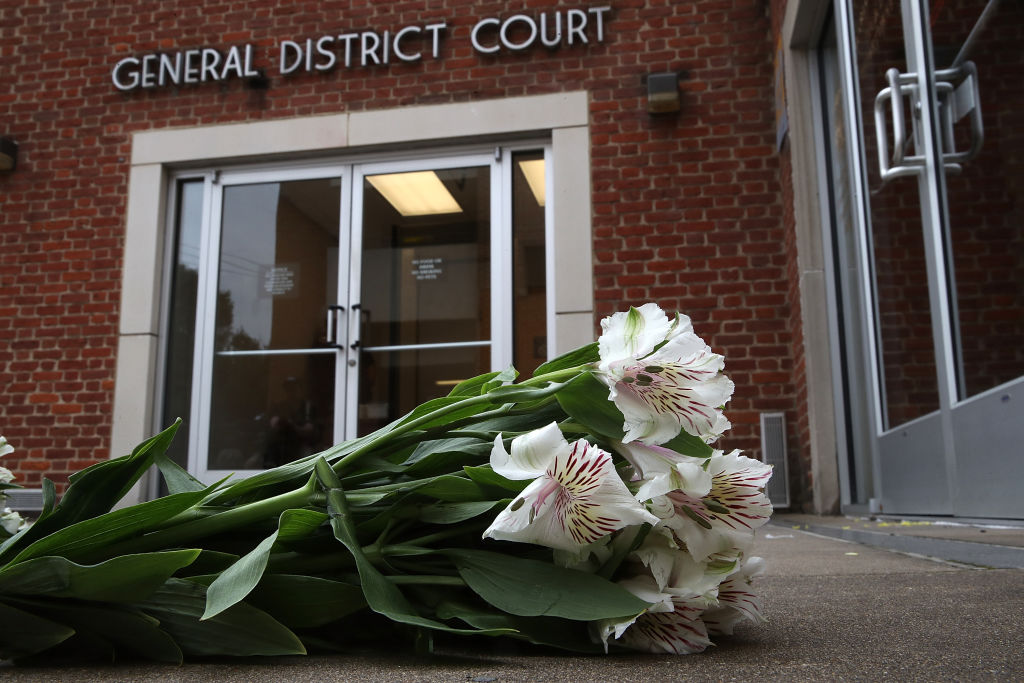 Flowers are left outside the Charlottesville General District Court before a scheduled appearance via video link for James Alex Fields Jr. August 14, 2017 in Charlottesville, Virginia. (Win McNamee/Getty Images)