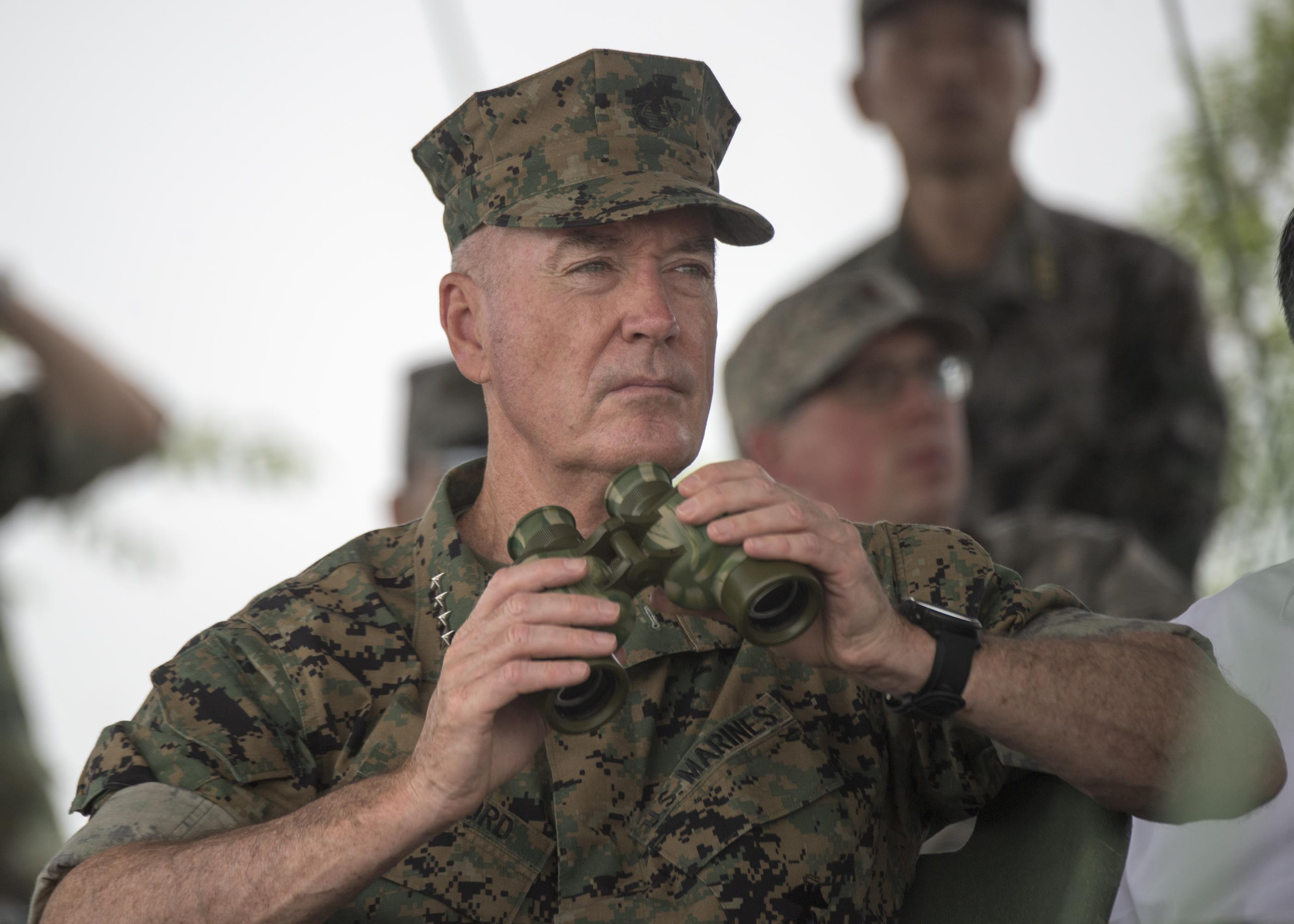 Marine Corps Gen. Joe Dunford, chairman of the Joint Chiefs of Staff, observes an attack exercise by Chinese troops at a Chinese army base in Shenyang, China, Aug. 16, 2017. (DoD photo by Navy Petty Officer 1st Class Dominique A. Pineiro)