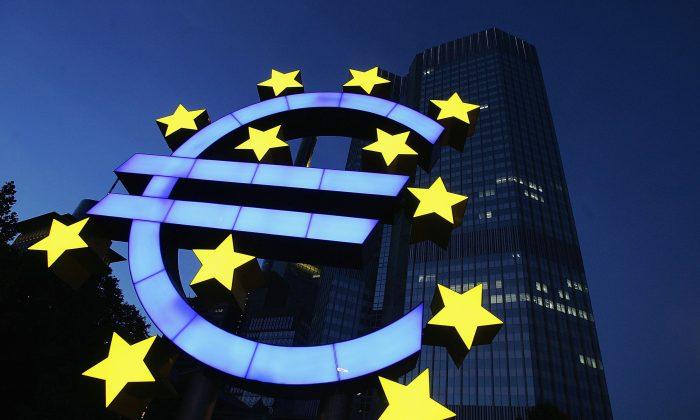 A huge euro logo is seen in front of the headquarters of the European Central Bank (ECB) in Frankfurt, Germany on June 13, 2005. (Ralph Orlowski/Getty Images)