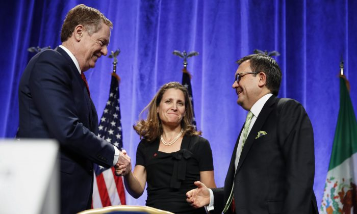U.S. Trade Representative Robert Lighthizer (L) shakes hands with Canadian Foreign Affairs Minister Chrystia Freeland, accompanied by Mexico's Secretary of Economy Ildefonso Guajardo Villarreal, after a news conference on Aug. 16, 2017 at the start of NAFTA renegotiations in Washington, D.C. (AP Photo/Jacquelyn Martin)