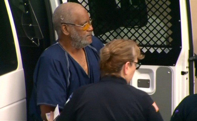 James Matthew Bradley Jr. is escorted from a prisoners van before appearing briefly in federal court, authorities found eight men dead in the back of his tractor trailer truck, in a still image from video taken in San Antonio, Texas on July 24, 2017. (Courtesy of KENS5.com/San Antonio, Texas via REUTERS)