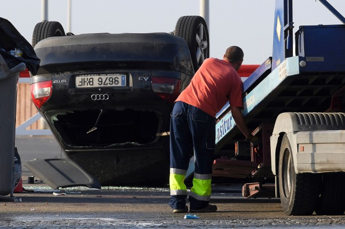 An employee starts to tow away a car involved in a terrorist attack in Cambrils, a city 120 kilometres south of Barcelona, on August 18, 2017. (LLUIS GENE/AFP/Getty Images)