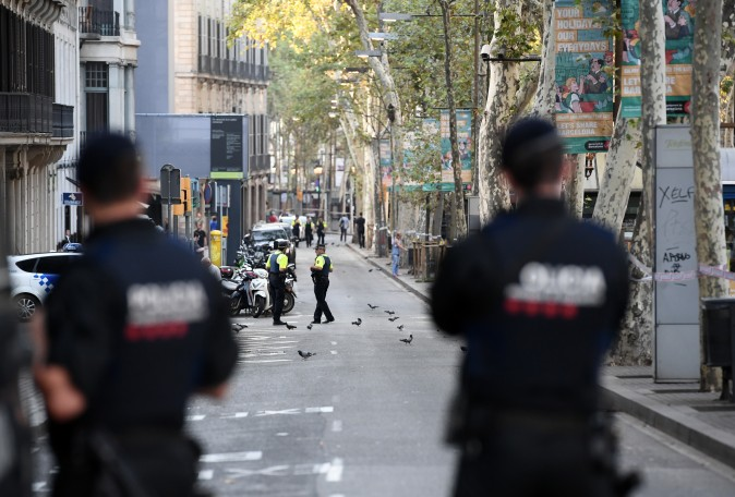 Police officers patrol on Las Ramblas following yesterday's terrorist attack, on August 18, 2017 in Barcelona, Spain. (Photo by Carl Court/Getty Images)