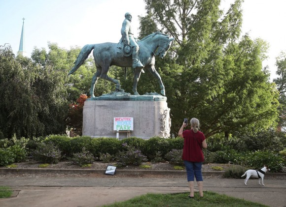 A homemade sign that says Heather Heyer Park rests at the base of the statue of Confederate Gen. Robert E. Lee that stands in the center of Emancipation Park on August 18, 2017 in Charlottesville, Virginia. (Mark Wilson/Getty Images)