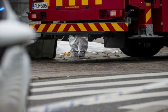 Rescue personnel have covered a stabbing victim's body at the Turku Market Square in the Finnish city of Turku where several people were stabbed on August 18, 2017. One person was killed and eight were injured in a stabbing spree in the Finnish city of Turku, a hospital director said, after police shot one suspect and warned several others could be at large.  (RONI LEHTI/AFP/Getty Images)