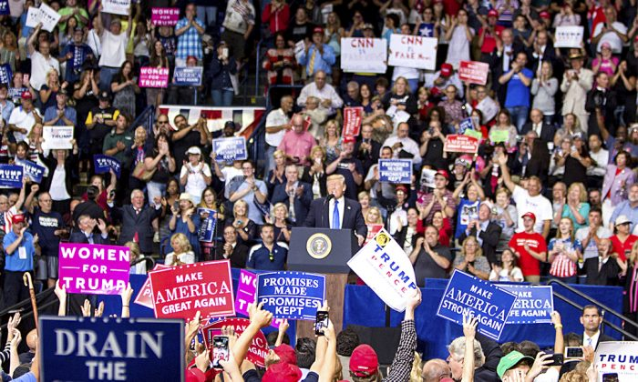 President Donald Trump acknowledges the crowd at a rally at the Covelli Centre in Youngstown, Ohio, on July 25.