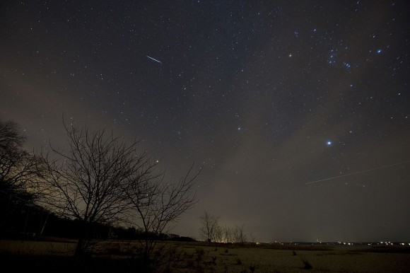 A meteor from the Geminids meteor shower (streak at top) enters the Earth's atmosphere on December 12, 2009 above Southold, New York. (STAN HONDA/AFP/Getty Images)