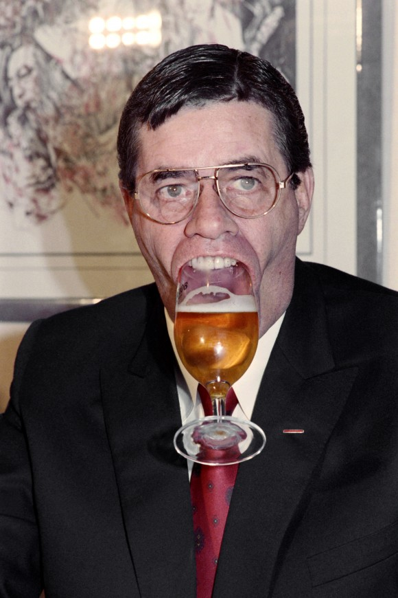 U.S. humorist, comedian, director, and singer Jerry Lewis holds a glass of beer with his mouth on Nov. 27, 1987 during a press conference in Paris.  (JEAN-LOUP GAUTREAU/AFP/Getty Images)