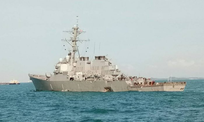 The guided-missile destroyer USS John S. McCain is seen after a collision, off Johor, Malaysia, in this handout August 21, 2017. Royal Malaysian Navy/Handout via Reuters