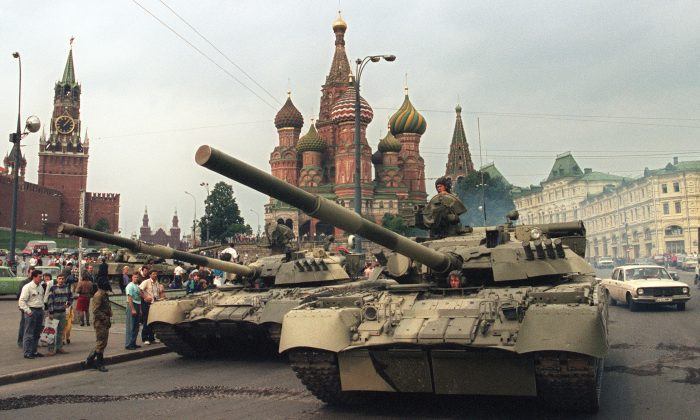 A picture taken on August 19, 1991 shows Soviet Army tanks parked near Spassky gate (L), an entrance to the Kremlin and Basil's Cathedral (C) in Moscow's Red Square after a coup toppled Soviet President Mikhail Gorbachev.   (Dima Tanin/AFP/Getty Images)