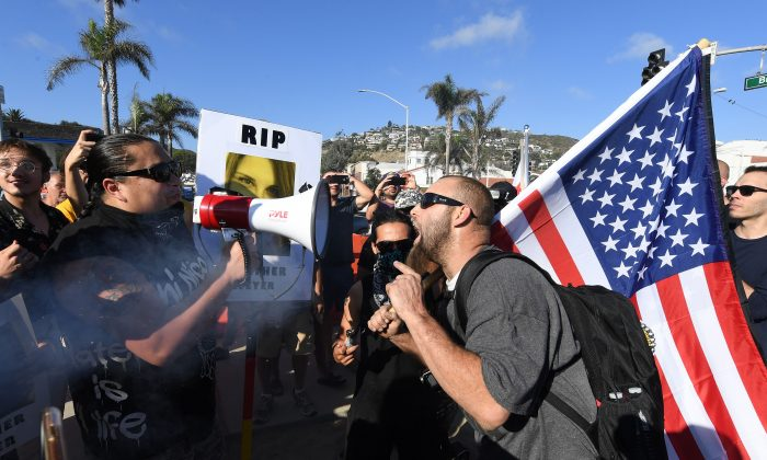 Protesters argue with each other at dual rallies in Laguna Beach, California, on Aug. 20, 2017. (MARK RALSTON/AFP/Getty Images)