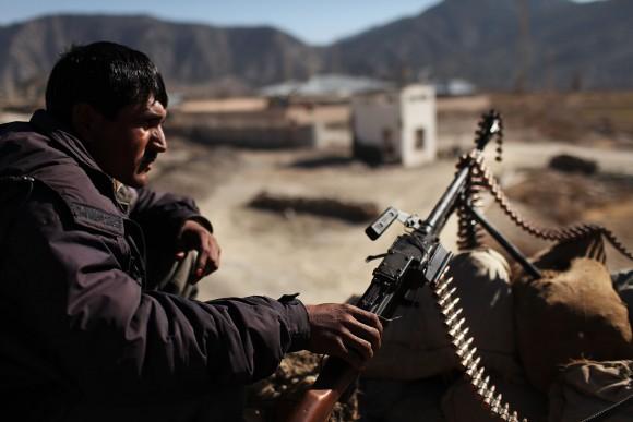 A member of the Afghan National Police keeps watch in Zerak, Afghanistan, on Jan. 21, 2010. (Spencer Platt/Getty Images)