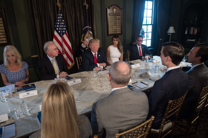 President Donald Trump speaks with administration officials on the opioid addiction crisis at the Trump National Golf Club in Bedminster, N.J., on August 8. (NICHOLAS KAMM/AFP/Getty Images)