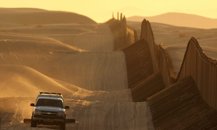 A Border Patrol vehicle drags the sand to make any new footprints of border crossers more visible along the US–Mexico border fence expansion between Yuma, Ariz., and Calexico, Calif., March 14, 2009. (David McNew/Getty Images)