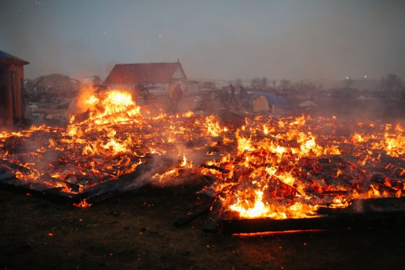 Activists and protesters set structures on fire in preparation of the Army Corp's 2pm deadline to leave the Oceti Sakowin protest camp on February 22, 2017 in Cannon Ball, North Dakota. (Stephen Yang/Getty Images)