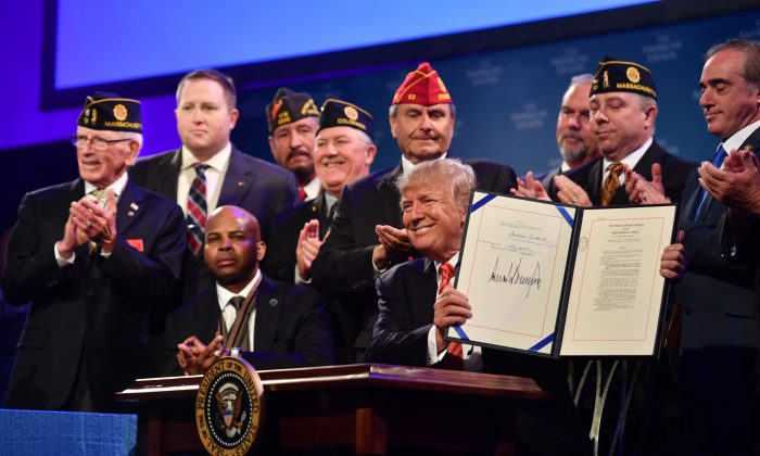 President Donald Trump after signing the Veterans Appeals Improvement and Modernization Act into law at the American Legion national convention in Reno, Nevada, on Aug. 23. (NICHOLAS KAMM/AFP/Getty Images)