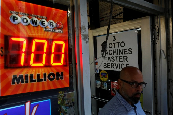 A screen displays the value of the Powerball jackpot at a store in New York City, U.S. on August 22, 2017. (REUTERS/Brendan McDermid)