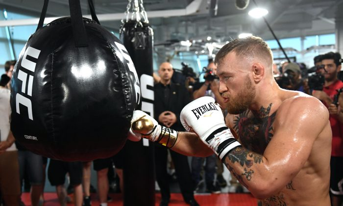 UFC lightweight champion Conor McGregor hits an uppercut bag during a media workout at the UFC Performance Institute in Las Vegas, Nevada on Aug. 11, 2017. McGregor will fight Floyd Mayweather Jr. in a boxing match at T-Mobile Arena on Aug. 26 in Las Vegas.  (Photo by Ethan Miller/Getty Images)