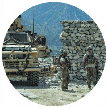 U.S. soldiers patrol in the Achin district of Afghanistan's Nangarhar Province on April 15. (PHOTO BY GETTY IMAGES)