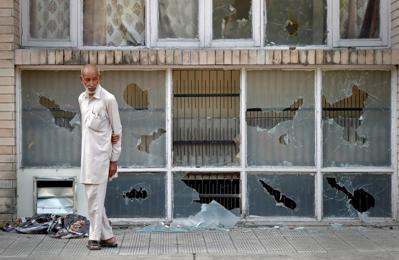 A man surveys the damage after a day of violence in Panchkula, India August 26, 2017. (Reuters/Cathal McNaughton)