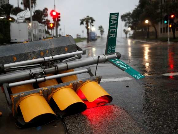 Traffic lights lie on a street after being knocked down, as Hurricane Harvey approaches in Corpus Christi, Texas. (REUTERS/Adrees Latif)