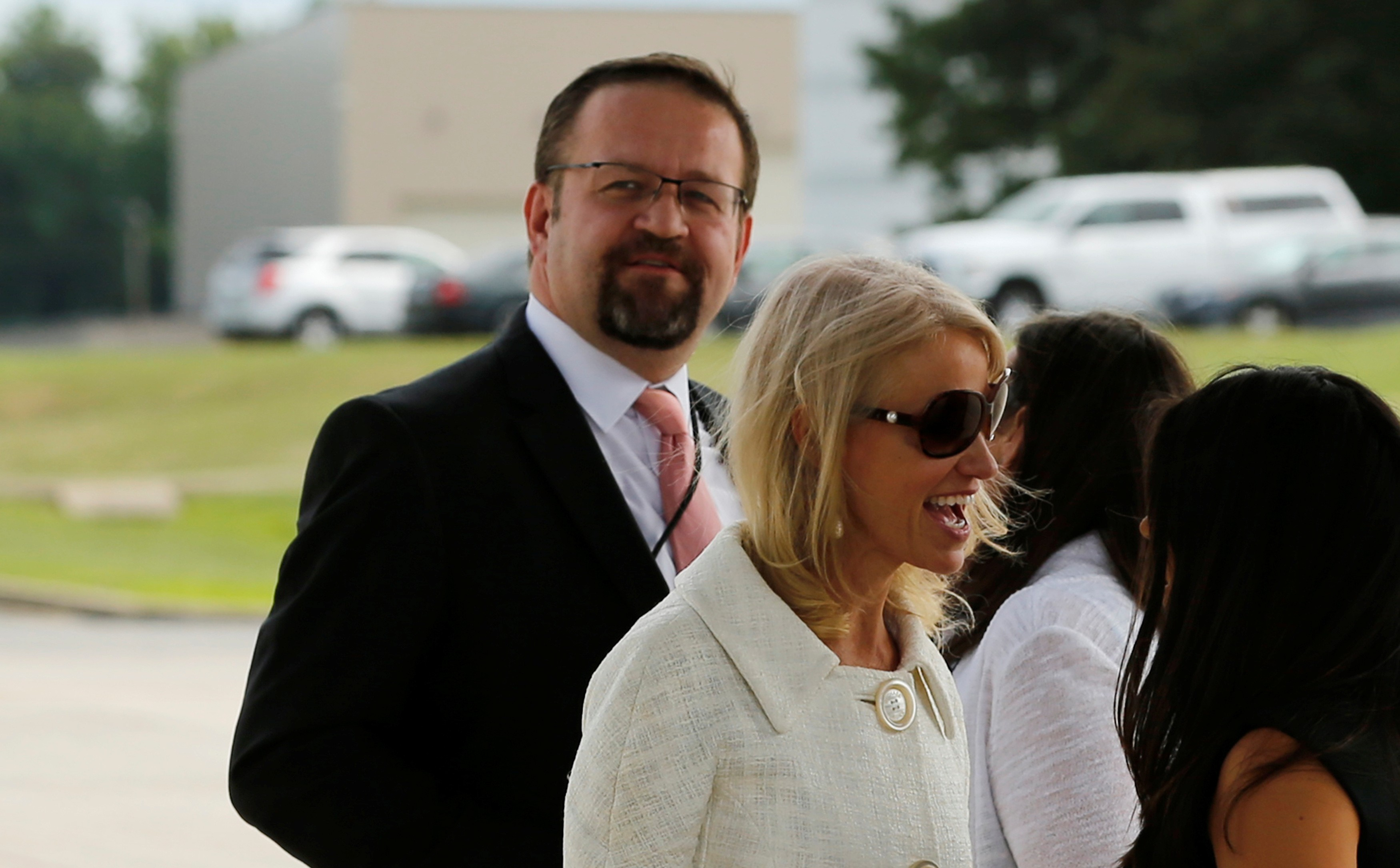 White House adviser Sebastian Gorka (L), standing with White House counselor Kellyanne Conway (C), waits for U.S. President Donald Trump to arrive to board Air Force One for travel to Ohio from Joint Base Andrews, Maryland on July 25, 2017. (REUTERS/Jonathan Ernst)