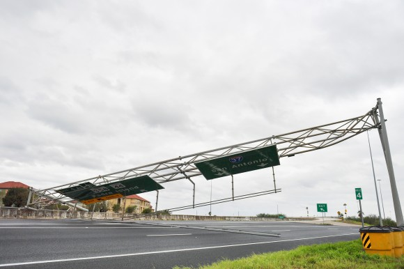 A collapsed overhead gantry lies across Interstate 37, blocking the highway due to damage caused by Hurricane Harvey in Corpus Christie, Texas, U.S., August 26, 2017.   REUTERS/Mohammad Khursheed?