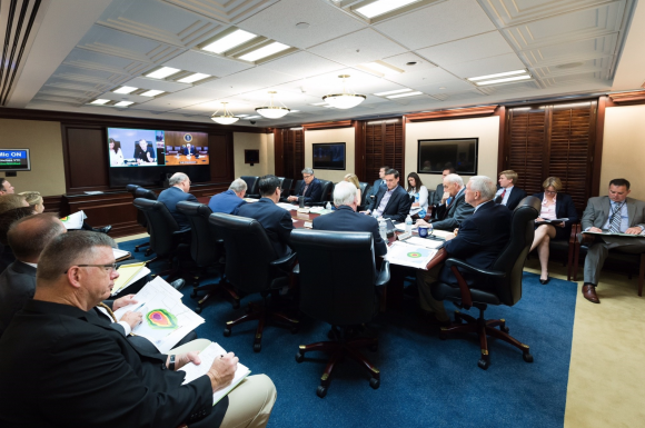 President Donald Trump is seen on screen in the White House Situation Room, as he conducts a video teleconference regarding an update on Hurricane Harvey, from a conference room at Camp David, on Aug. 26, 2017. (Official White House Photo by Andrea Hanks)​