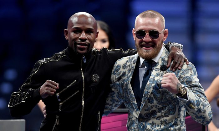 (L-R) Floyd Mayweather Jr. and Conor McGregor pose for pictures after Mayweather's 10th round TKO victory in their super welterweight boxing match at T-Mobile Arena in Las Vegas on Aug. 26, 2017. (Ethan Miller/Getty Images)