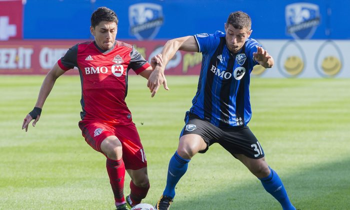 Montreal Impact's Blerim Dzemaili (R) challengesTorontoFC's Marky Delgado at Stade Saputo in Montreal on Aug. 27, 2017. TFC extended its unbeaten streak to nine games with the important win on the road. (The Canadian Press/Graham Hughes)