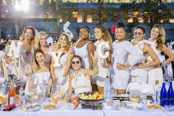 Guests attend the annual Diner en Blanc at Lincoln Center in New York on Aug. 22, 2017.  (Eric Vitale for Diner en Blanc)