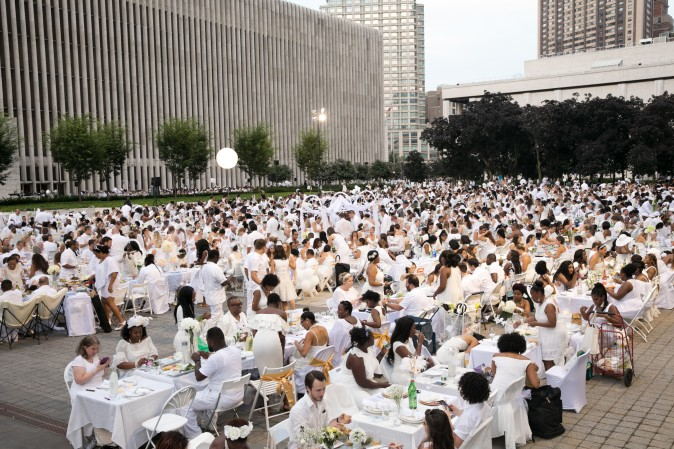 Guests attend the annual Diner en Blanc at Lincoln Center in New York on Aug. 22, 2017. Diner en Blanc began in France nearly 30 years ago and is held around the world. (Hal Horowitz for Diner en Blanc)