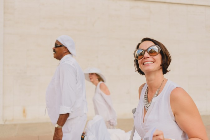 Guests walk to the location of the annual Diner en Blanc in New York on Aug. 22, 2017. Diner en Blanc began in France nearly 30 years ago and is held around the world. (Light Feather for Diner en Blanc)