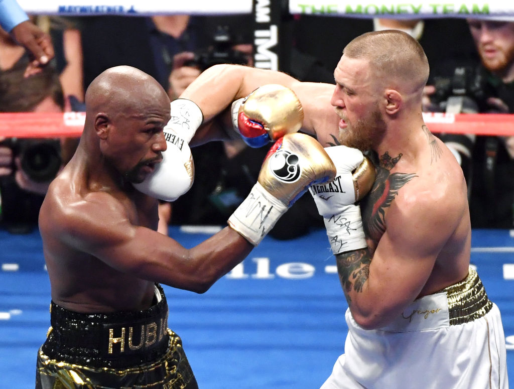 Floyd Mayweather (L) and Jr. Conor McGregor battle in the sixth round of their super welterweight boxing match at T-Mobile Arena on August 26, 2017 in Las Vegas, Nevada. (Ethan Miller/Getty Images)