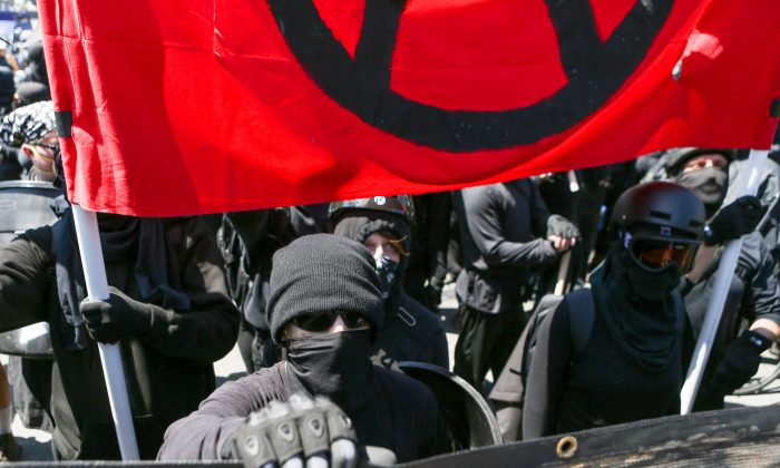 Far left Antifa extremists gather at Martin Luther King Jr. park in Berkeley on Aug. 27, 2017. The extremists attacked small groups of pro-Trump and conservative protesters. (AMY OSBORNE/AFP/Getty Images)
