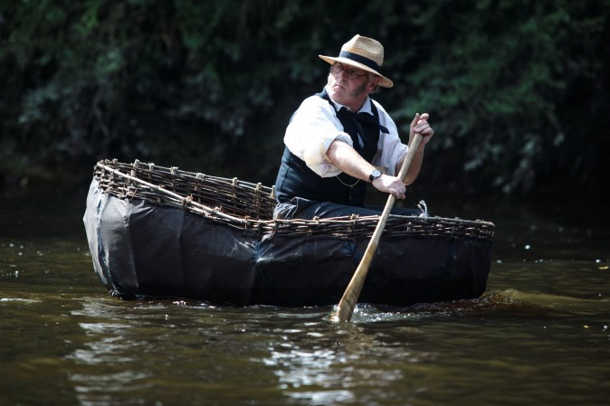 Coracler Conwy Richards from Norfolk takes part in the 30th annual Ironbridge Coracle Regatta on the River Severn in Ironbridge, United Kingdom, on Aug. 28, 2017. A coracle is a small boat made from an interwoven wooden frame and is used traditionally for fishing or transportation. (Jack Taylor/Getty Images)