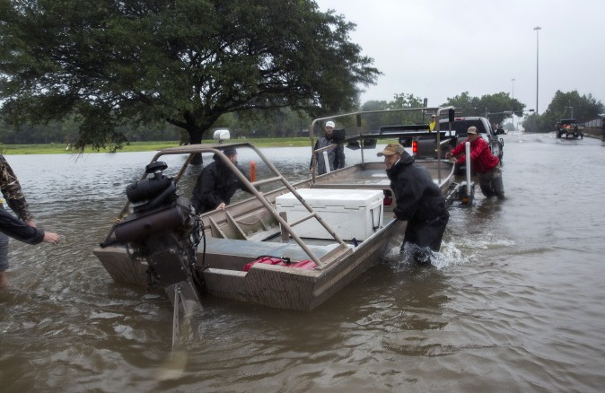 Volunteer search and rescuers from Passion Pursuit film production company launch their motor boat near Bray Bayou and Loop 610 to rescue flood victims in the Meyerland neighborhood  after Hurricane Harvey inundated the area Aug. 28, 2017 in Houston, Texas. (Erich Schlegel/Getty Images)