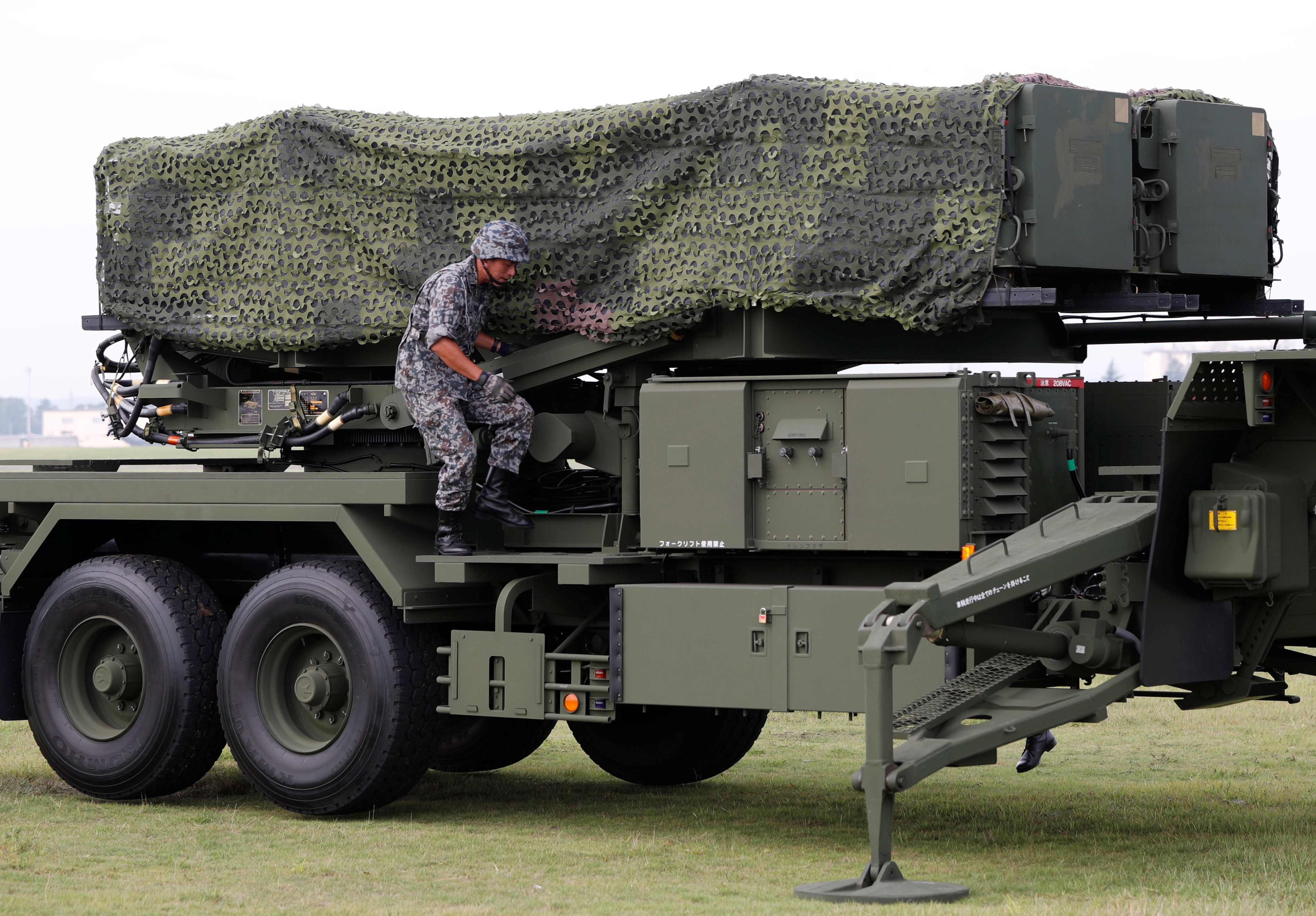 A Japan Self-Defense Forces (JSDF) soldier takes part in a drill to mobilise their Patriot Advanced Capability-3 (PAC-3) missile unit in response to a recent missile launch by North Korea, at U.S. Air Force Yokota Air Base in Fussa on the outskirts of Tokyo, Japan on Aug. 29, 2017. (REUTERS/Issei Kato)
