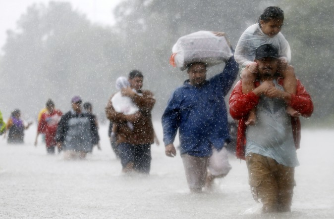 Residents wade through flood waters from Tropical Storm Harvey in Beaumont Place, Houston, Texas, U.S., on August 28, 2017. (REUTERS/Jonathan Bachman)